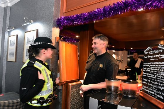 Pc Lindsey Dow and Murray Gordon, owner at Station Hotel, Stonehaven. Picture by Jim Irvine