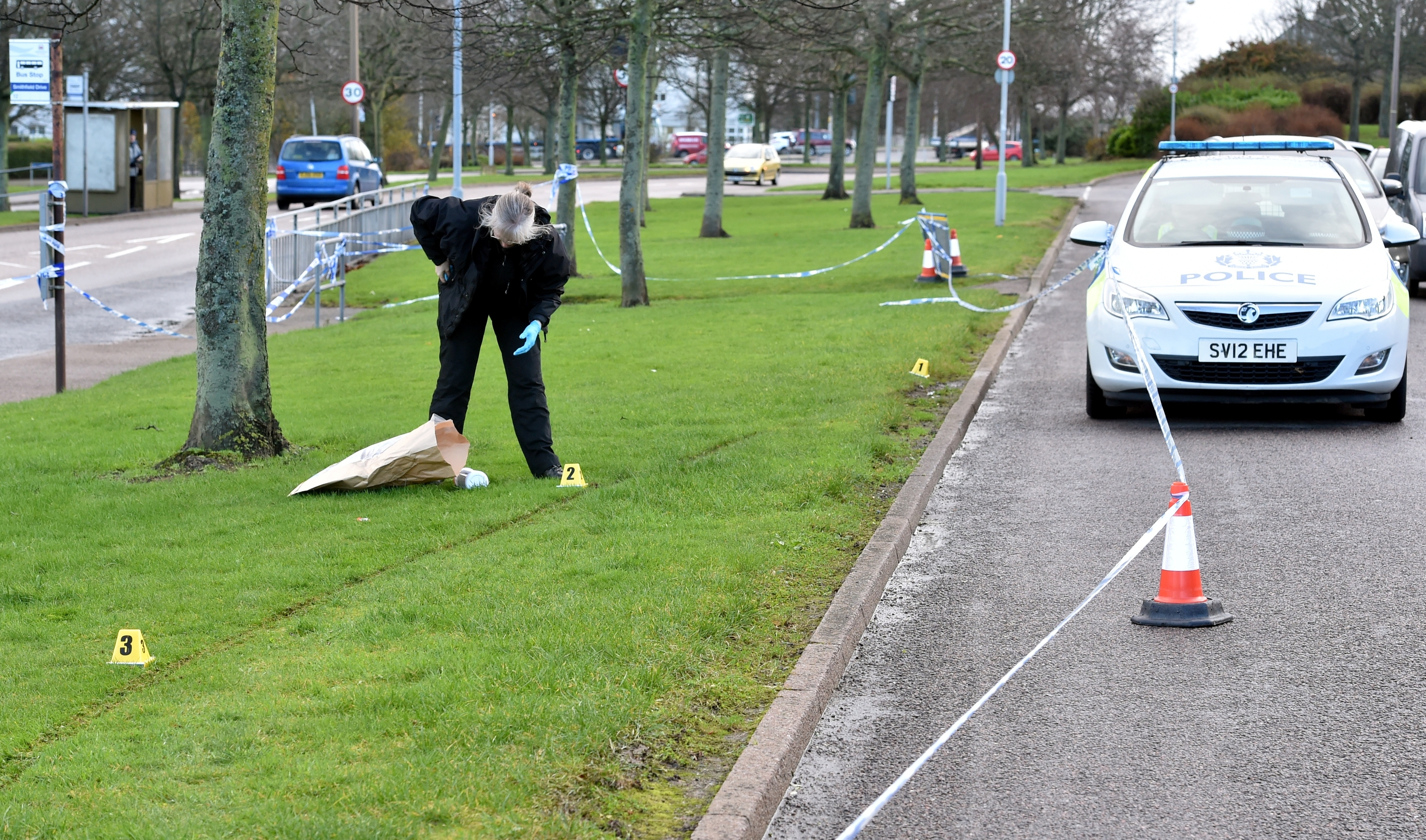 A section of grass is cordoned off at Provost Rust Drive, Aberdeen with police in attendance.