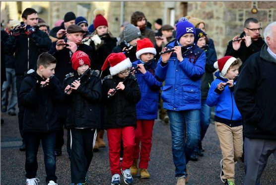 THE INVERSAINTCAIRN FLUTE BAND LEADS THE CHRISTMAS DAY WALK THROUGH THE VILLAGES OF CAIRNBULG AND INVERALLOCHY. Picture Duncan Brown