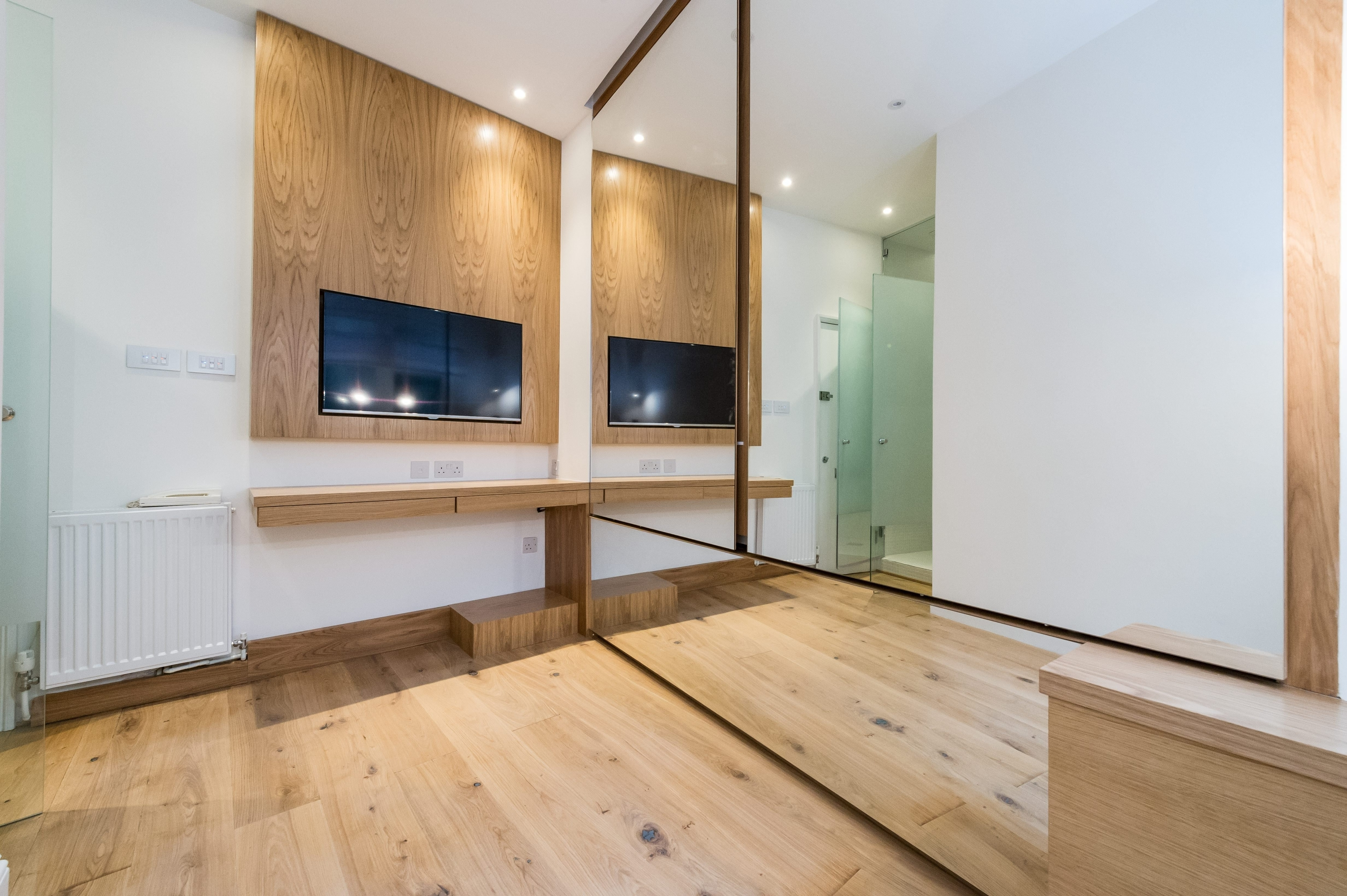 A studio apartment which is smaller than a single garage has been put on the market for more than three times the average house price.