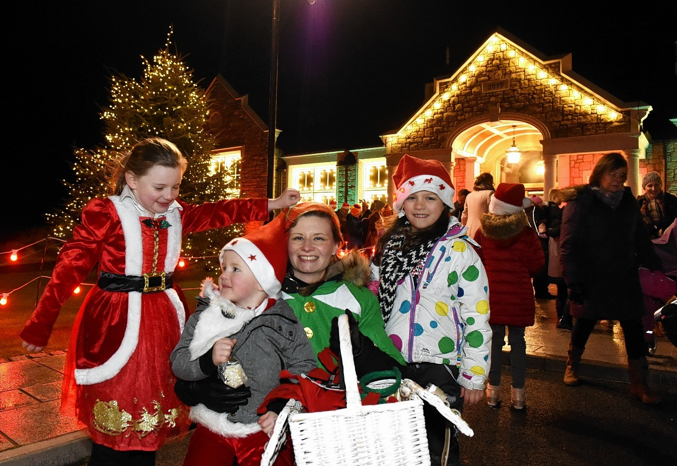 Chloe, Sam and Nicola Wilson with Millie Buchan at the Christmas light switch on at Trump International Golf Course