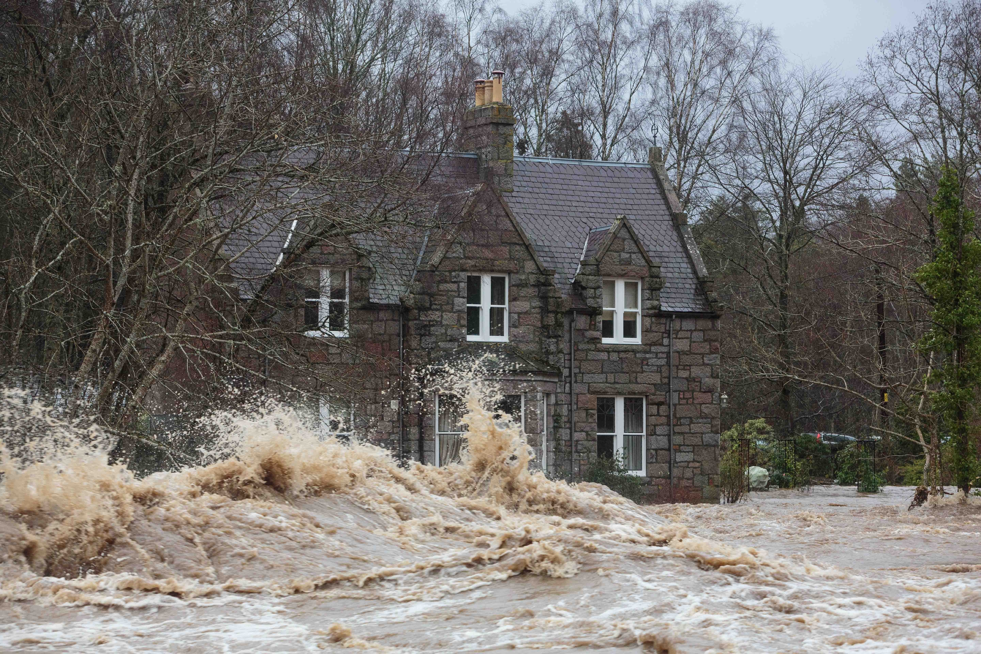 A house on the bank of the River Dee near Dinnet