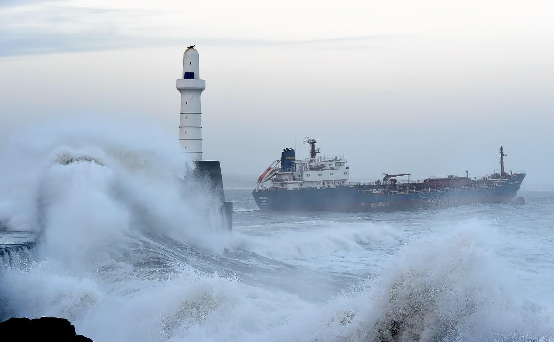 Wave batter the Aberdeen coastline.