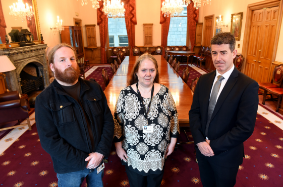 Caption: (from left) Simon Pringle, Services manager for Drugs Action, Councillor Lesley Dunbar, Aberdeen Council and Detective Inspector Graham Smith, Domestic Abuse Investigation Unit, at Aberdeen Town House launching a unique scheme in Aberdeen over the festive period to help those affected by domestic abuse.