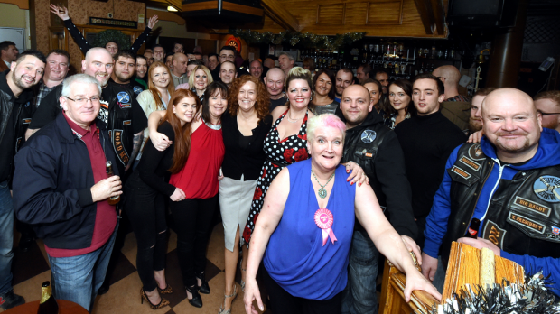 Val Morrison, centre, with the regulars of the Crown and Anchor on what they thought would be the bar's final night