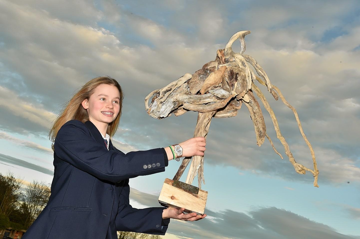 Millie Wark, 13, with her prize-winning sculpture