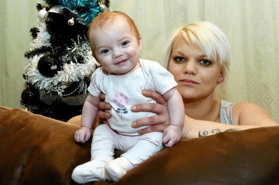 Jenna Wilson with her baby Ava at home in Cairnbuig