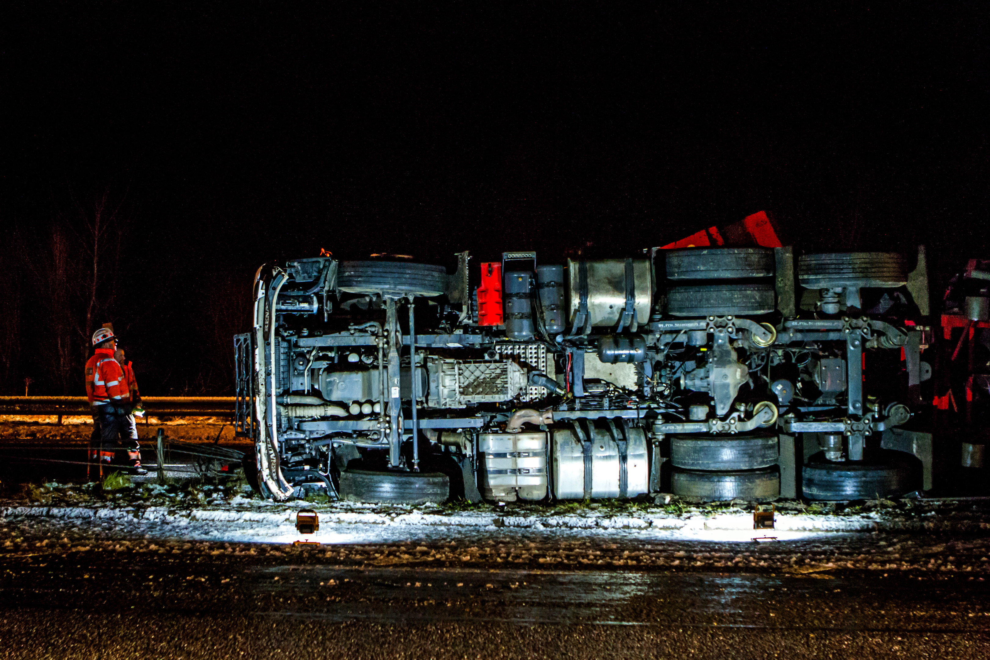 Steve MacDougall, Courier, A9 Dual Carriageway one Mile North of Pitlochry. Pictured, overturned lorry on A9 with emergency services at the scene.