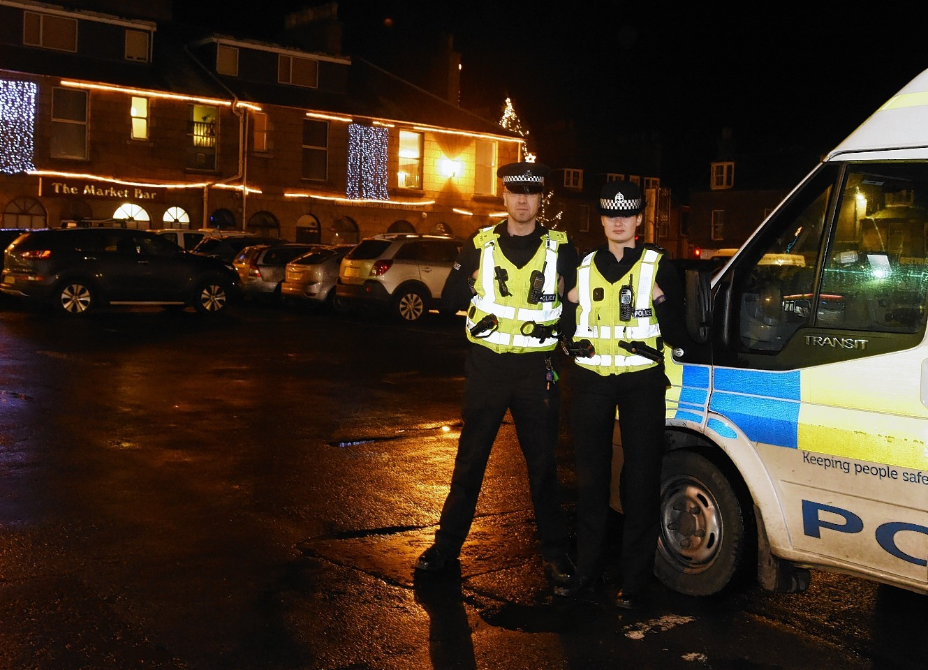 PC Lindsey Dow and PC Mark Irvine at Trouper's bar Stonehaven. Picture by Jim Irvine