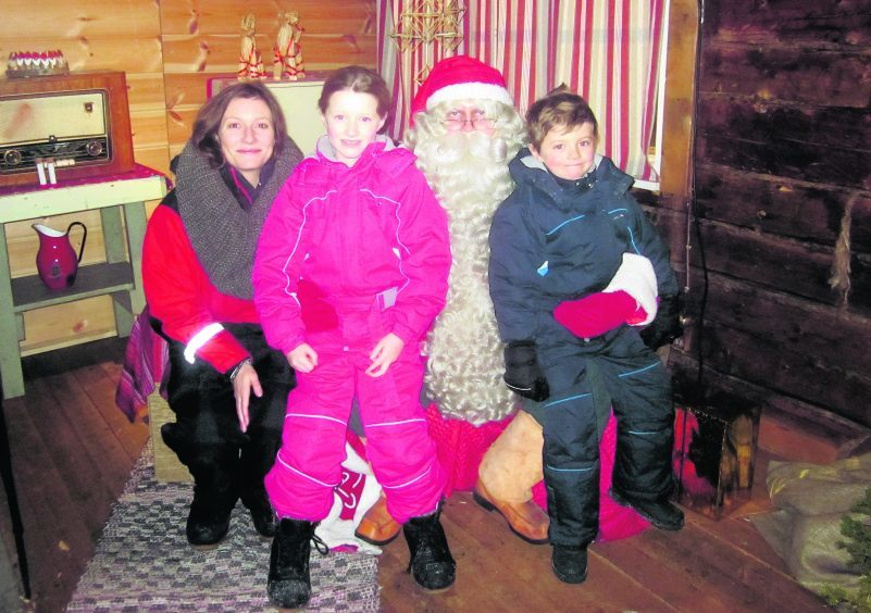 Emily Shelley with her children, Felix and Beatrice, meeting Santa