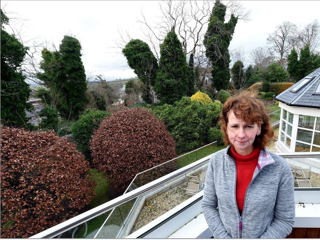 Mrs Bochel beside the fallen tree. Picture by Jim Irvine