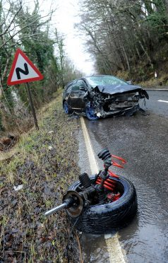 The A82 south of Urquhart Castle where a  white Vauxhaul Corsa van and a black Honda Civic crashed