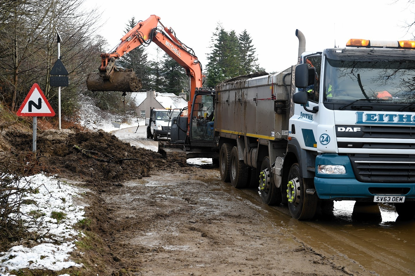Moray Council roadworkers clearing up the landslip