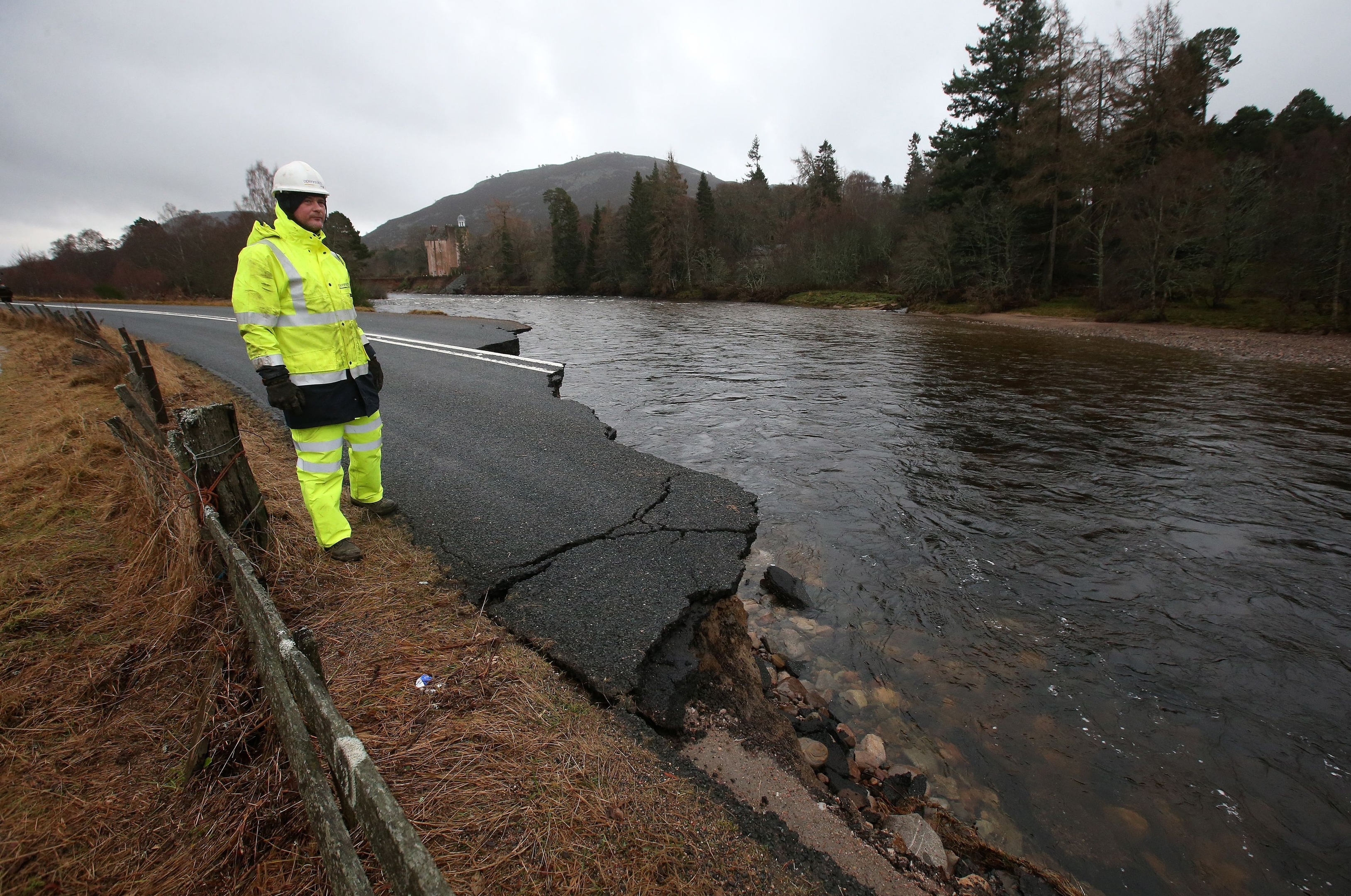 BT Engineers view the damage on the A93 Ballater to Braemar road after the River Dee washed it away in storms last week. PRESS ASSOCIATION Photo. Picture date: Wednesday January 6, 2016. Photo credit should read: Andrew Milligan/PA Wire