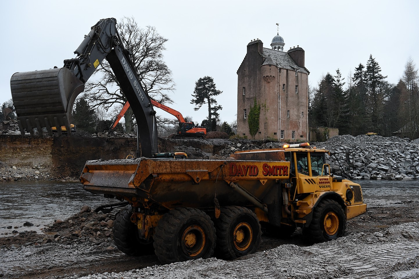 Work to save Abergeldie Castle after it was almost washed into the River Dee. Pictures by Kenny Elrick and Kami Thomson
