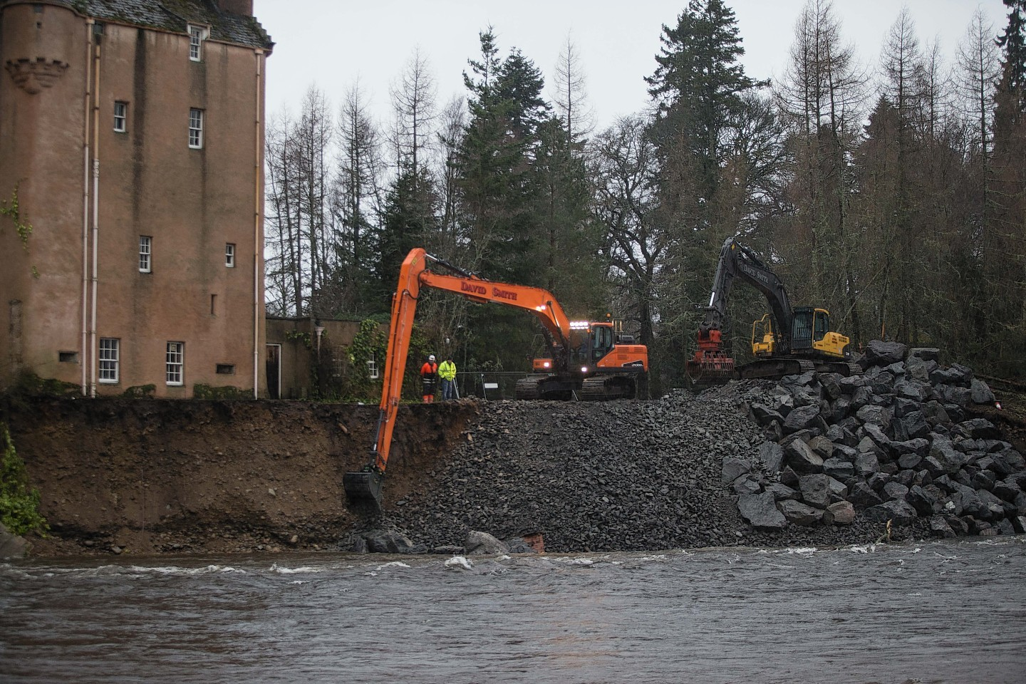 Boulders are placed by the castle in an effort to protect the historic building from the river