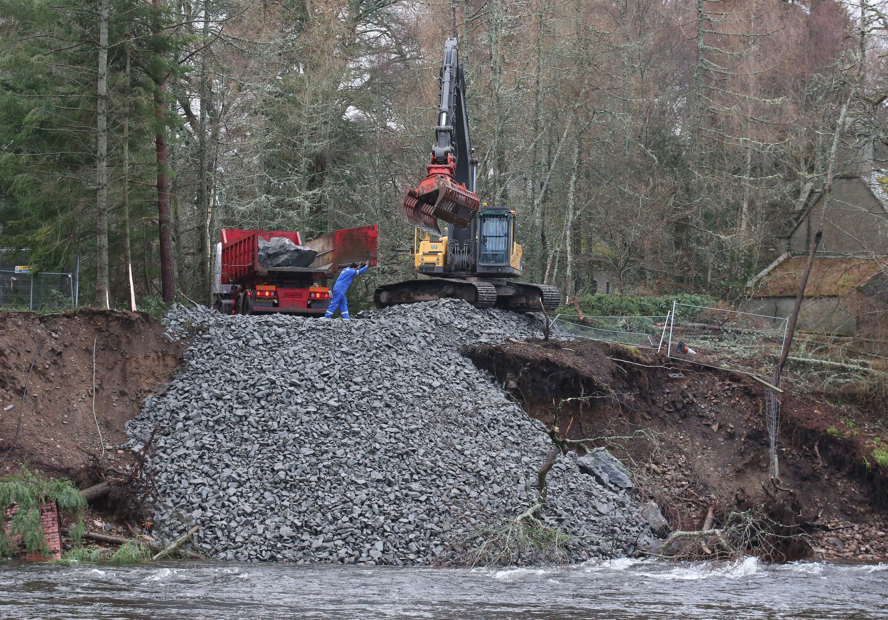 Rocks and boulders are moved to protect the shoreline on the River Dee  after Abergeldie Castle came close to being  washed  away in storms last week. PRESS ASSOCIATION Photo. Picture date: Wednesday January 6, 2016. Photo credit should read: Andrew Milligan/PA Wire