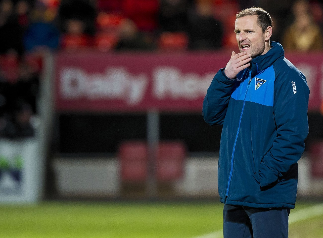 Dunfermline manager Allan Johnston watches on in Dingwall