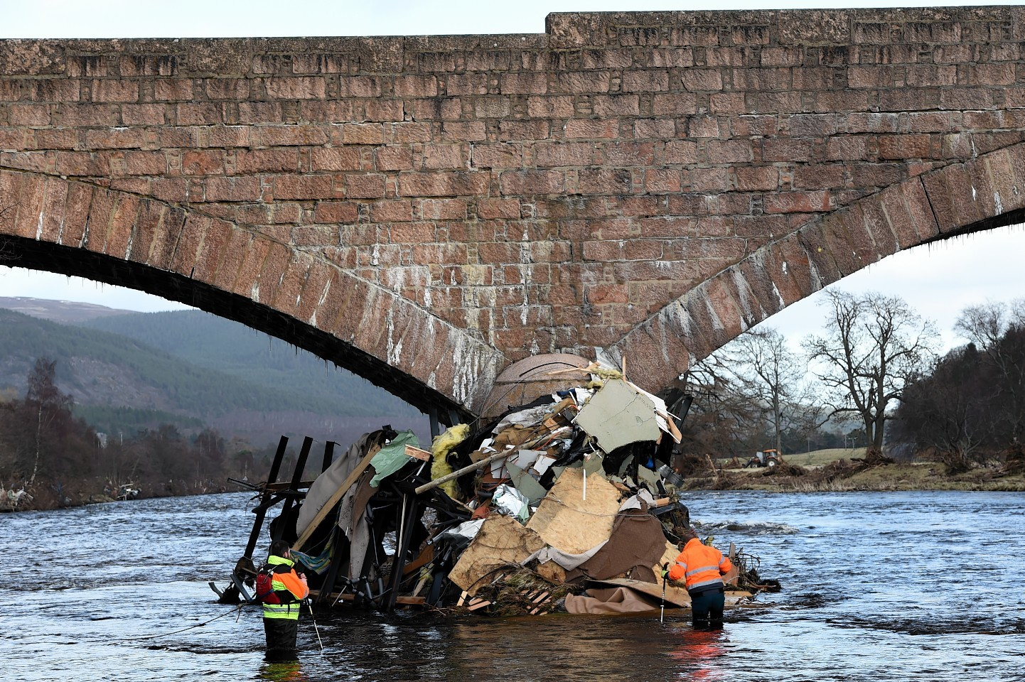 The clean-up of the Ballater Bridge after floods left a huge amount of debris lying under the structure has been delayed for another week due to rising water. Picture by KENNY ELRICK