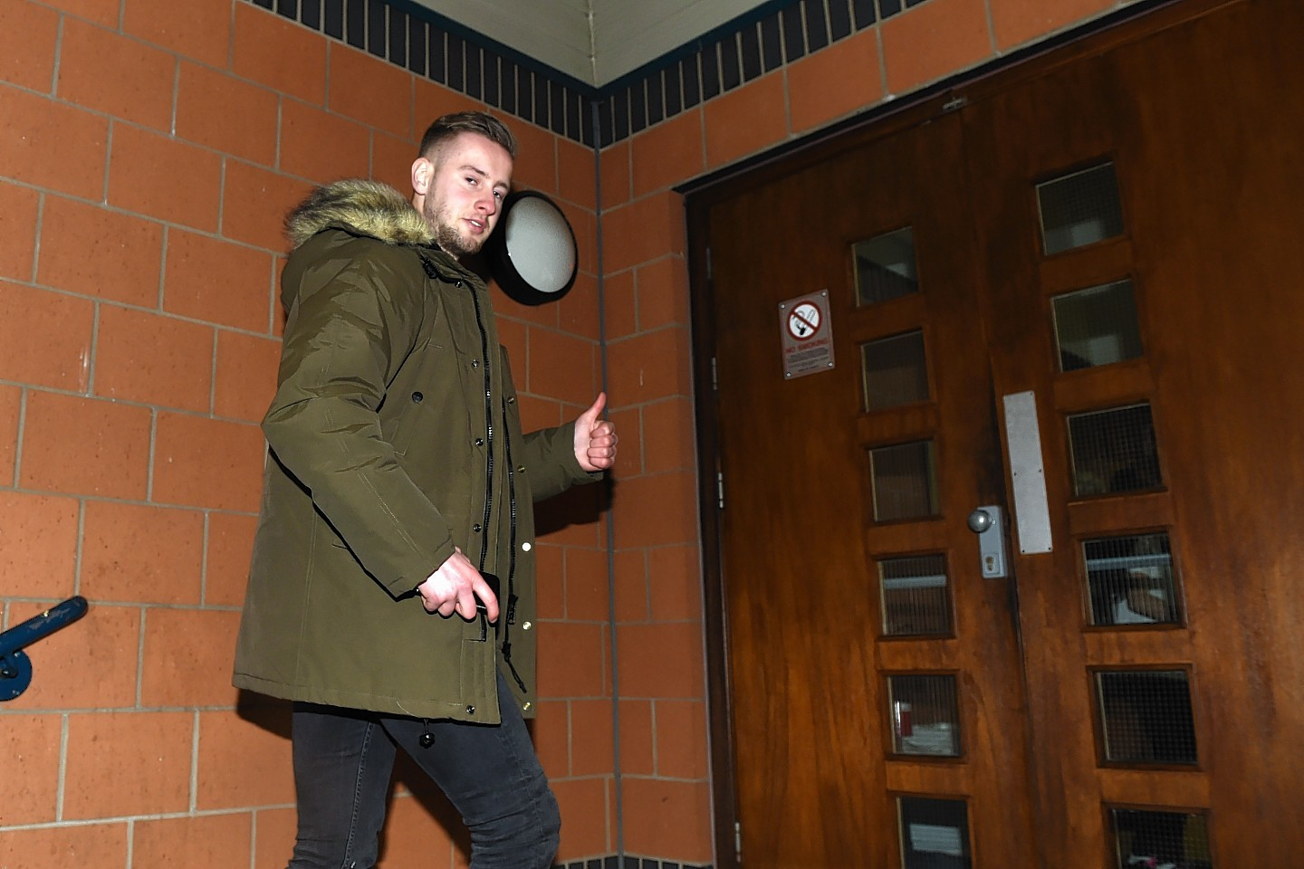 Billy King gives the cameras the thumbs up as he arrives at Murray Park to complete his move