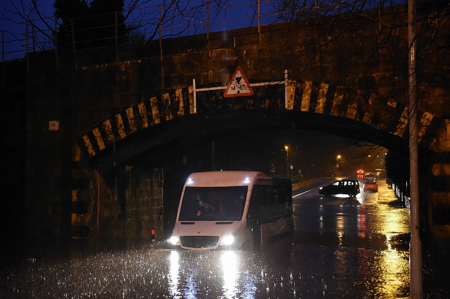 A bus trapped by the floods on Stoneywood Road in Dyce. Pictures by Kenny Elrick