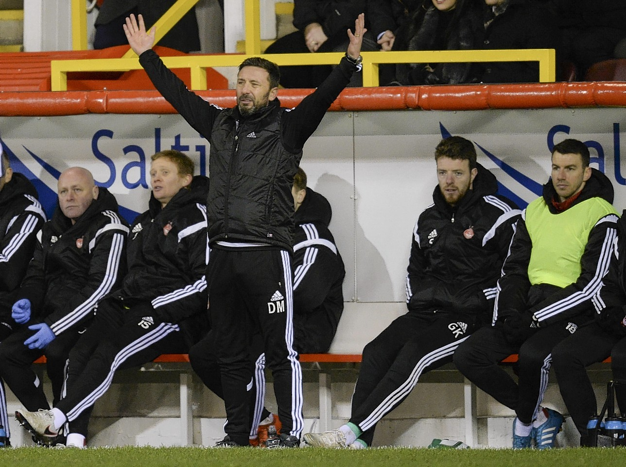 Aberdeen manager Derek McInnes encourages his players from the sidelines