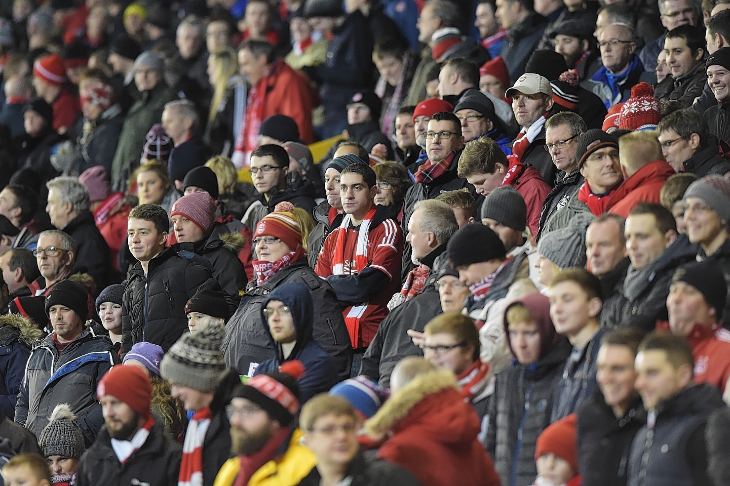 The Red Army take in the action at Pittodrie.