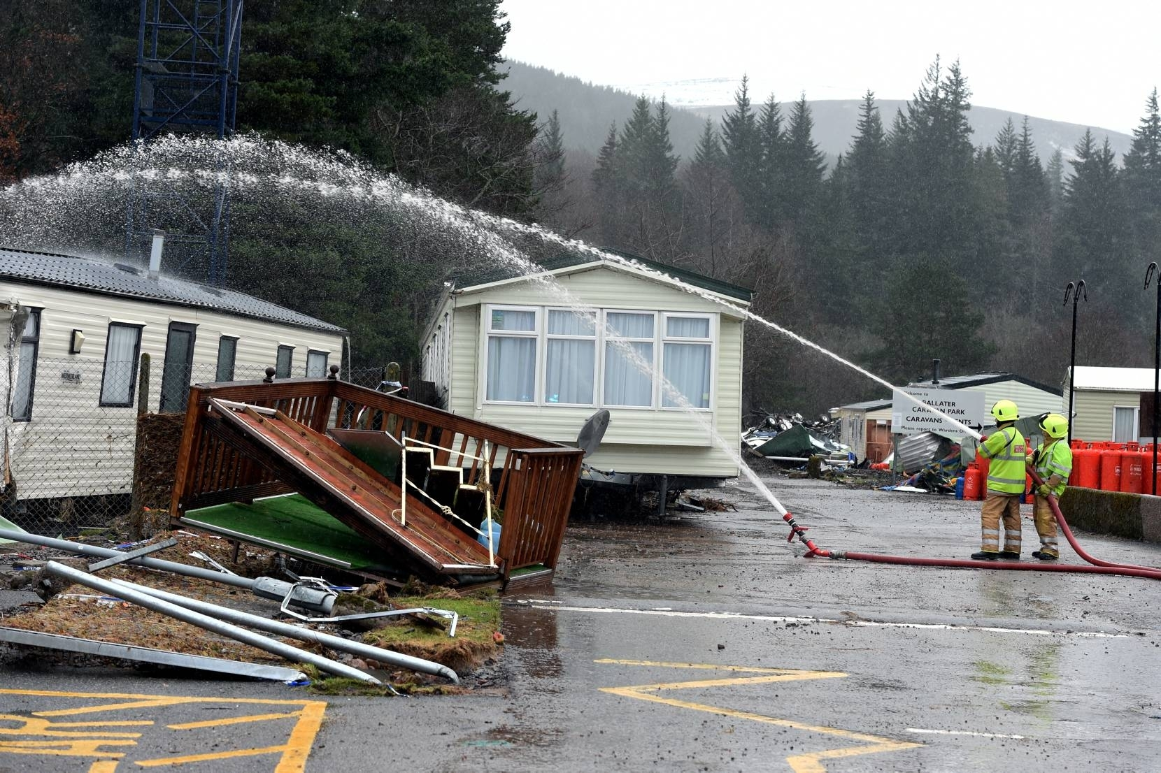 Flooding in Ballater. Fire fighters try to unblock the drains at the caravan park. Picture by Jim Irvine