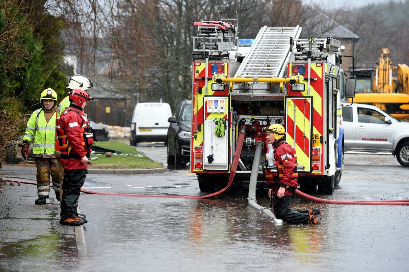 Fire crews try to clear flood water in Ballater