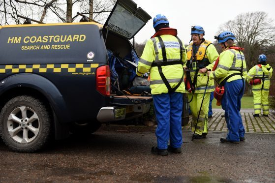 Search for missing Aberlour woman. Coastguards gather at Aberlour before searching along the River Spey. PictureS by Gordon Lennox