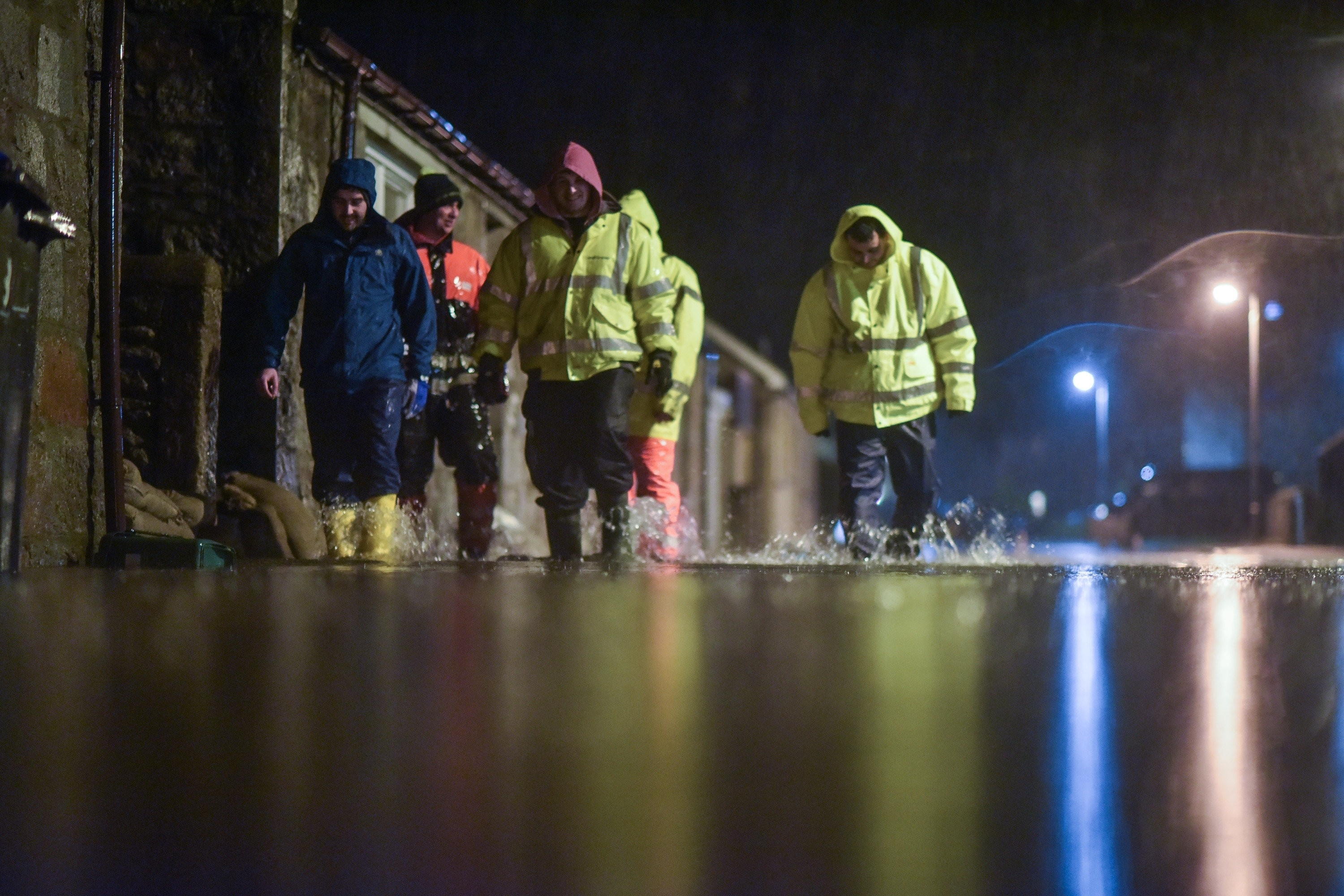 Men search homes in the Port Elphinstone area of Inverurie, Aberdeenshire as they begin to experience flooding after the River Don burst its banks on January 07 2016. Scottish Envornmental Protection Agency (SEPA) have issued two severe flood warnings for both Inverurie and Kintore, both in Aberdeenshire.