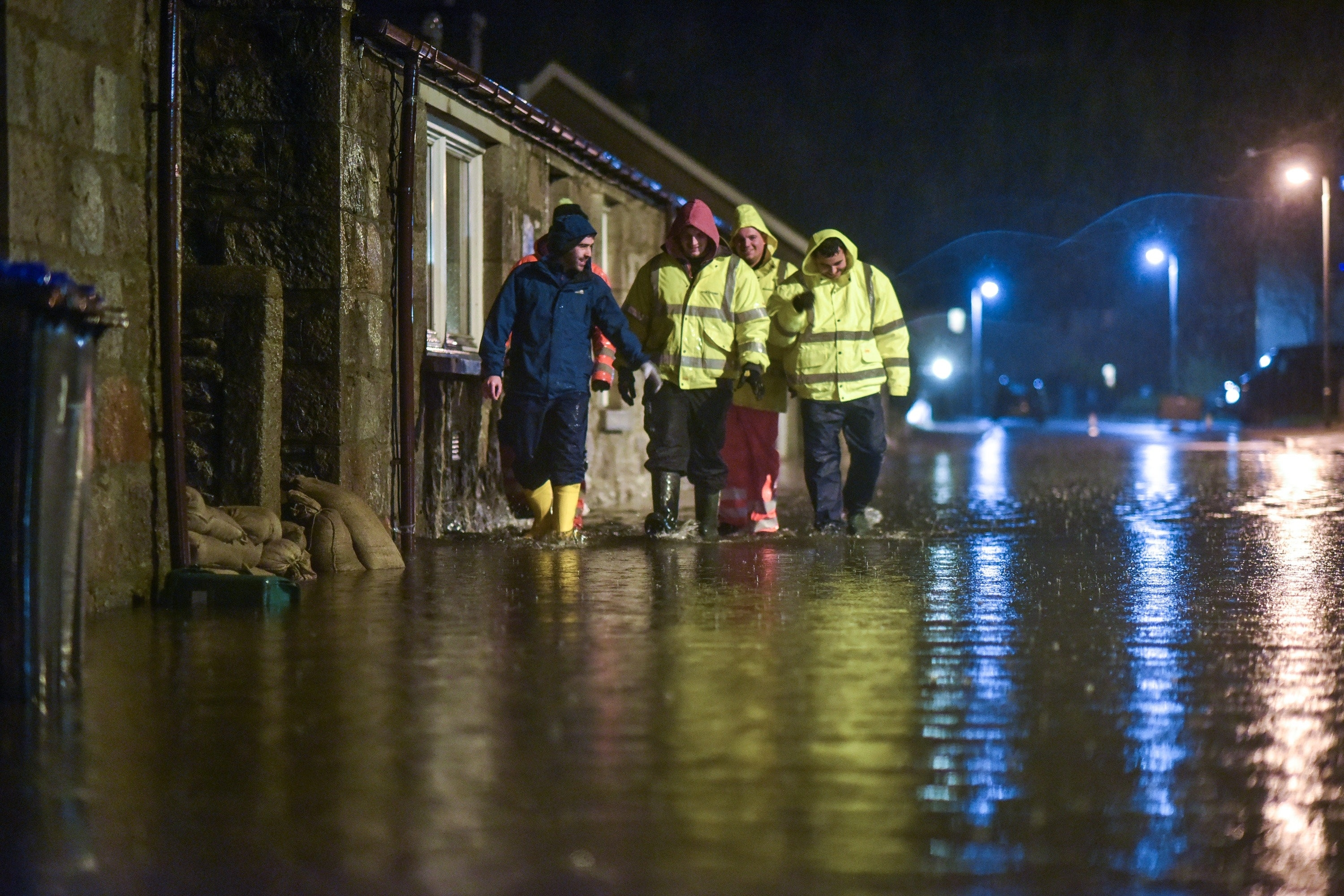 Men search homes in the Port Elphinstone area of Inverurie, Aberdeenshire as they begin to experience flooding after the River Don burst its banks on January 07 2016. Scottish Envornmental Protection Agency (SEPA) have issued two severe flood warnings for both Inverurie and Kintore, both in Aberdeenshire, tonight.