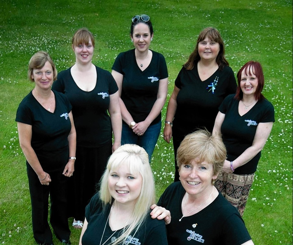 Kinloss Military Wives Choir members  Sheila Thompson, Christina Padbury, Laura Pettifar, Lorna Alexander and Julie McMillan.  At the front from the left Becca George and Felicity Sayers.