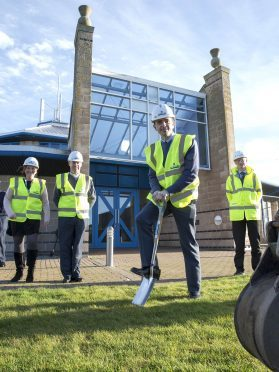 The Station Commander Gp Capt Godfrey, breaks ground at the new extension build at the St Adeins church, RAF Lossiemouth