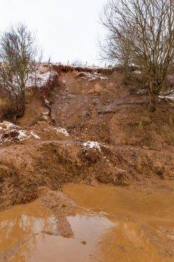 Hundreds of tonnes of mud block the road