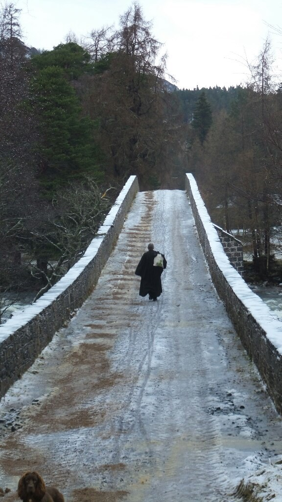 The Reverend Ken MacKenzie, of Braemar and Crathie Parish, took to the bridge on his way to deliver a sermon in Crathie this morning. Credit: Simon Blackett.