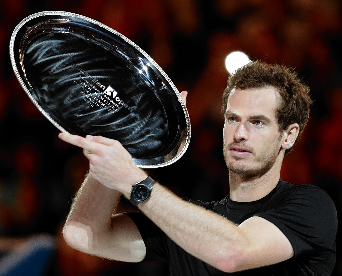 Murray holds aloft the runners-up trophy at last year's Australian Open