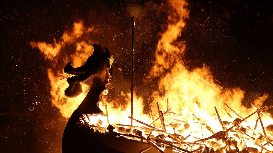 The Galley is burned by Guizer Jarl Mark Evans and members of the Jarl Squad, during the Up Helly Aa Viking festival in Lerwick on the Shetland Isles