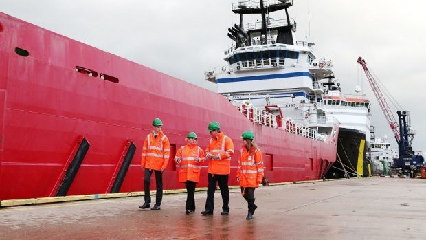 David Cameron receives a tour of Aberdeen Harbour in Scotland