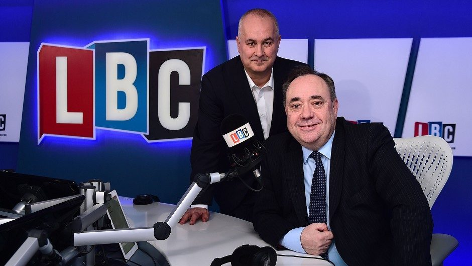 Alex Salmond (right) takes part in his first live weekly phone-in on radio station LBC, hosted by presenter Iain Dale (left)