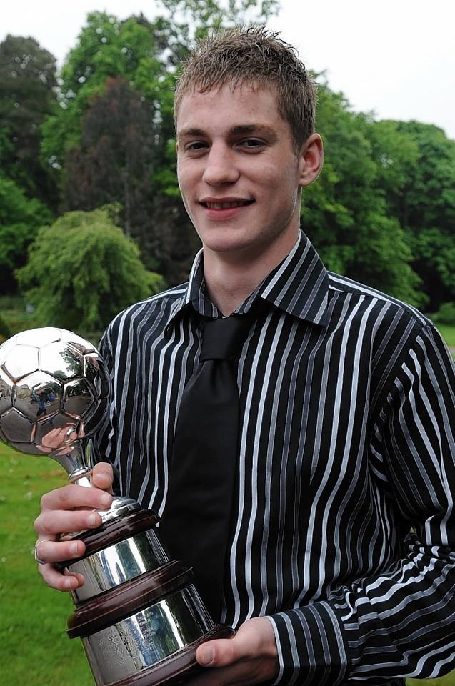 Coutts collects the player of the year award while playing for Cove