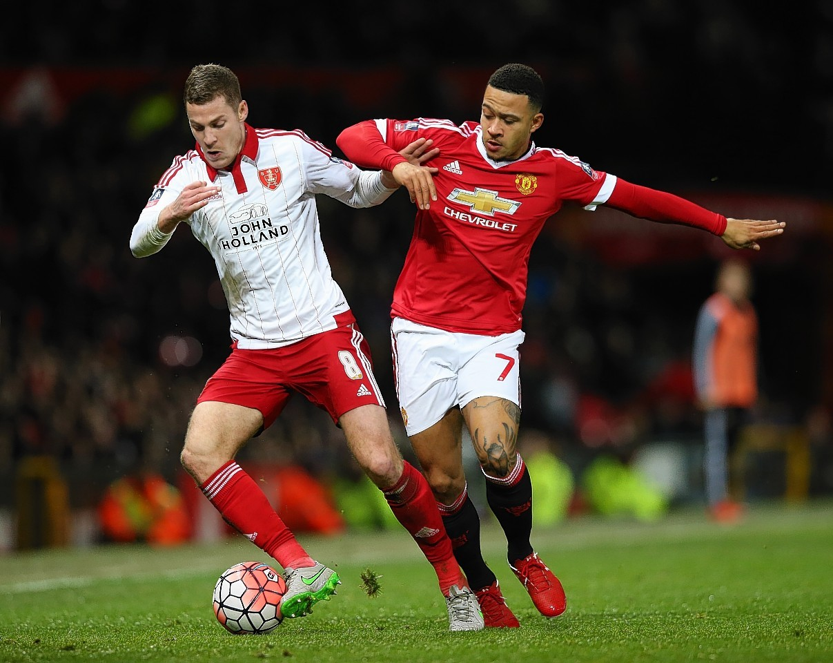 Coutts takes on Memphis Depay of Manchester United