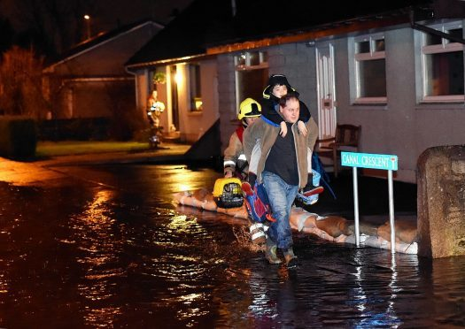 Residents are evacuated by police and fire & rescue service from Canal Road and Crescent at Port Elphinstone