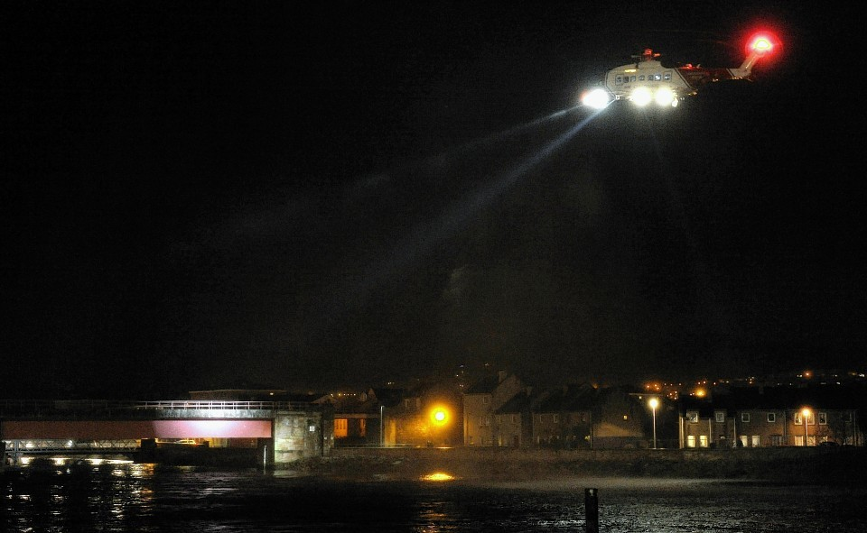 Emergency services, including coastguard helicopter, police, ambulance and the North Kessock Lifeboat search the River Ness after Marek Michalak fell