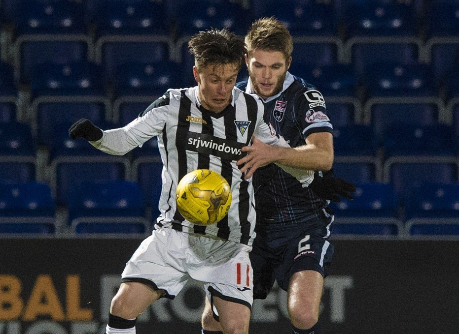 Dunfermline's Joe Cardle (left) holds off Marcus Fraser