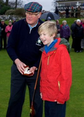Royal Dornoch Captain Jim Seatter and 12-year-old Cameron Welsh