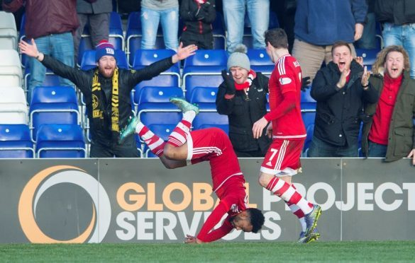 Shay Logan celebrates his first goal against Ross County