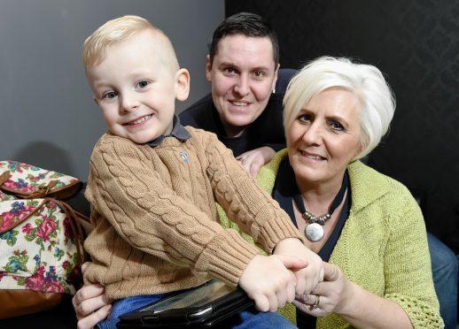 Sylvia Mackenzie with her son Jason and grandson Kayson