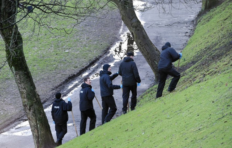 Police officers search Union Terrace Gardens after a woman was raped in January