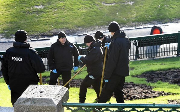 Police officers search Union Terrace Gardens in the days after the rape. (Picture: Kami Thomson)
